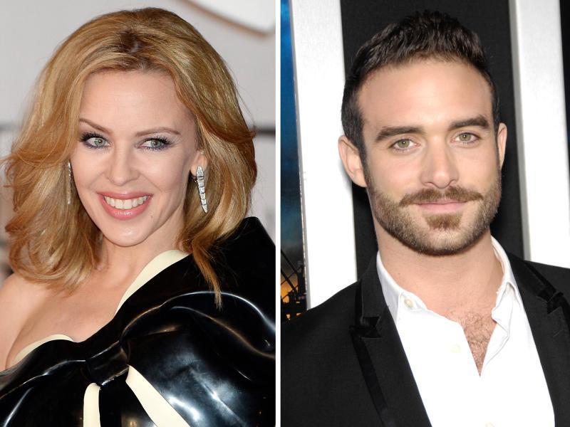 Bild zu Kylie Minogue und Joshua Sasse