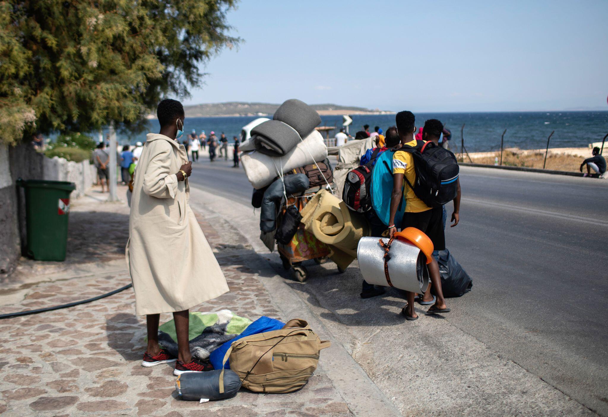 Bild zu Migranten