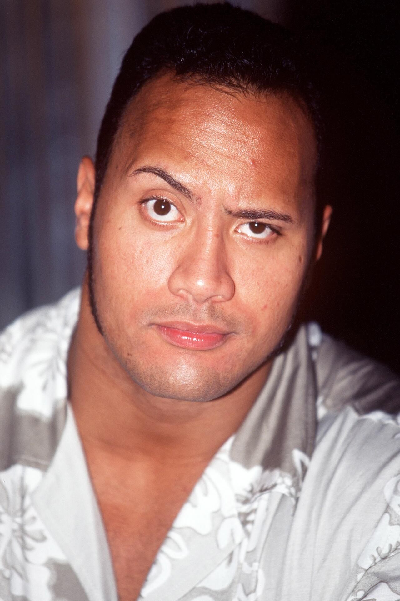 Bild zu Dwayne Johnson, The Rock, Haare, 90er