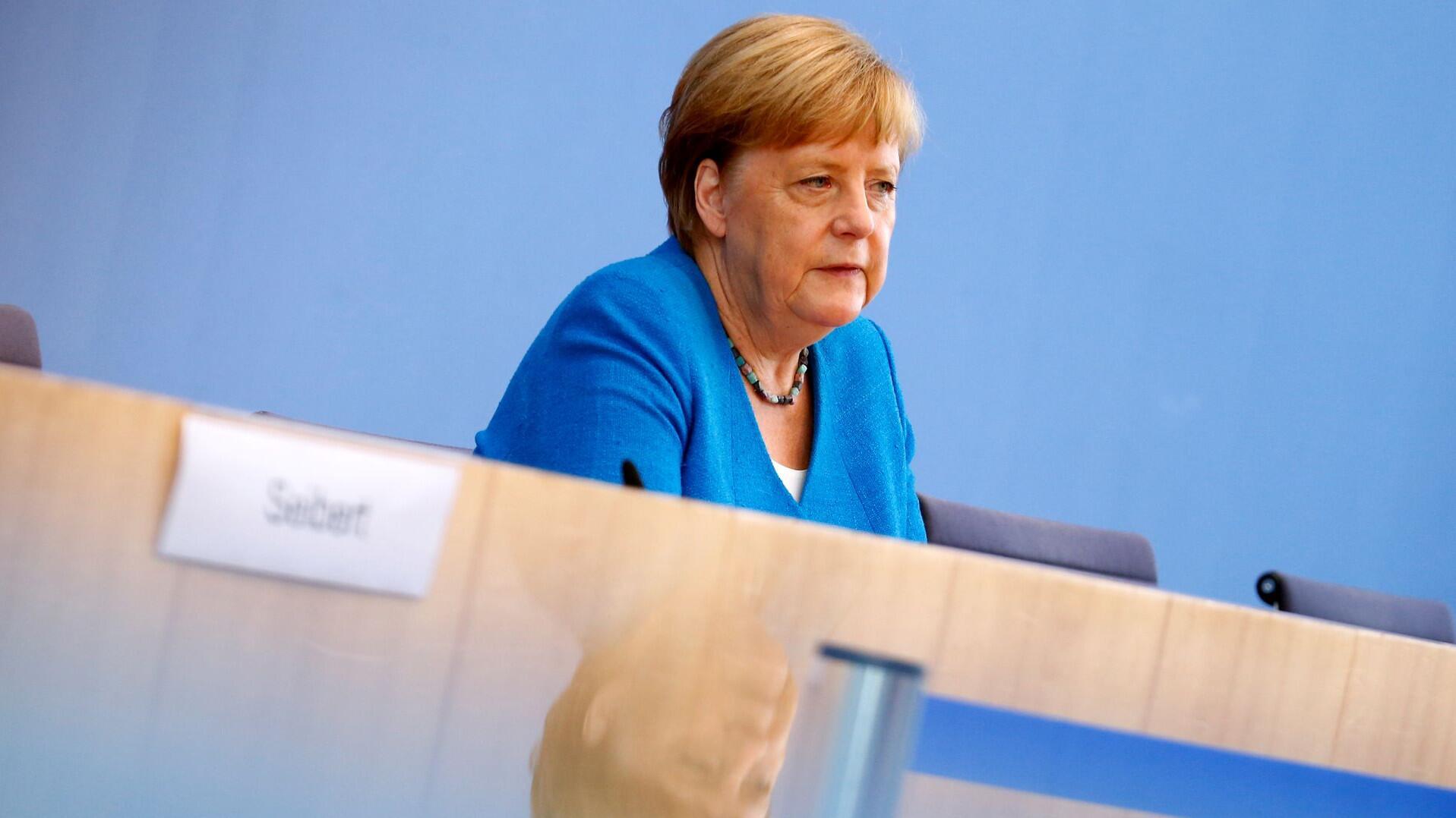 Bild zu Pressekonferenz mit Bundeskanzlerin Merkel