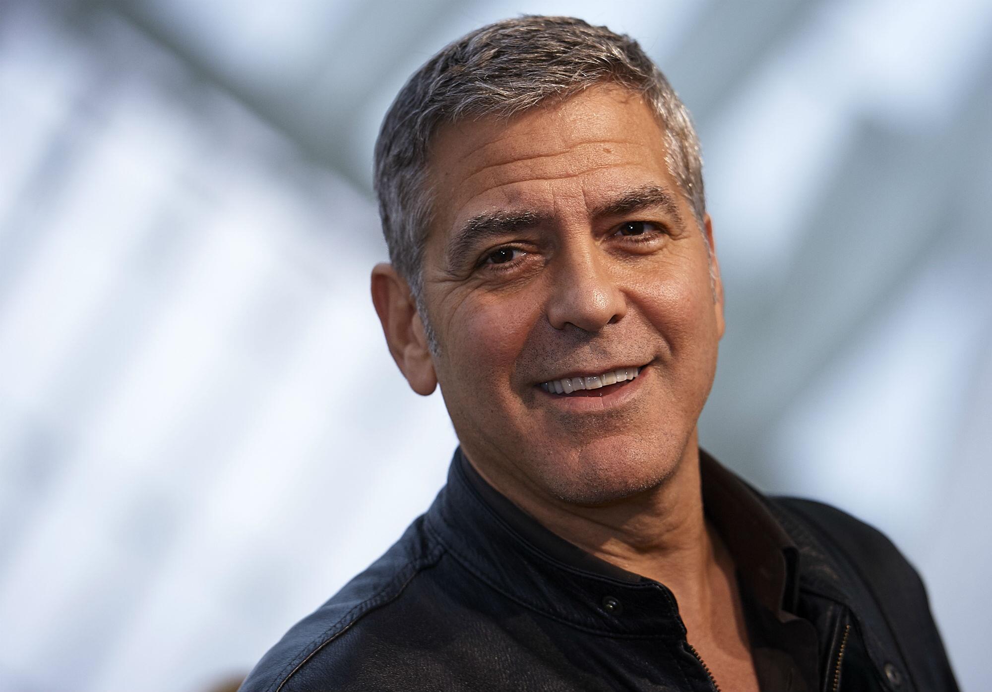 Bild zu George Clooney, Angela Merkel