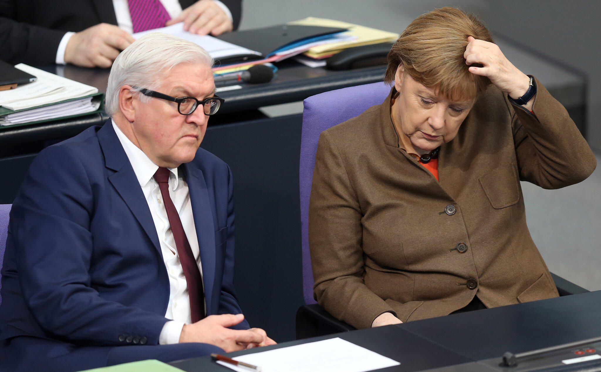 Bild zu Angela Merkel und Frank-Walter Steinmeier