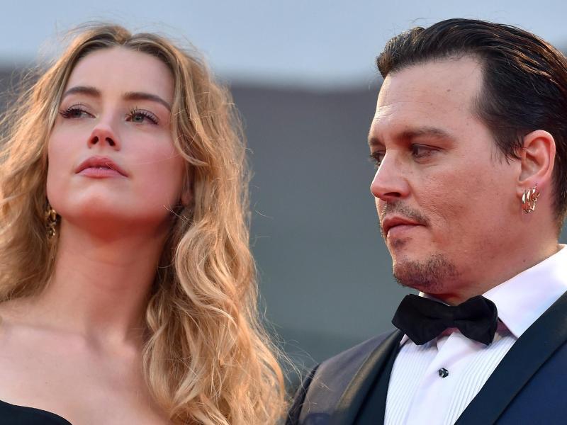 Bild zu Amber Heard und Johnny Depp