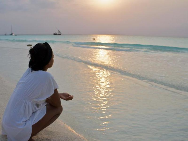 Bild zu Strand bei Sonnenuntergang