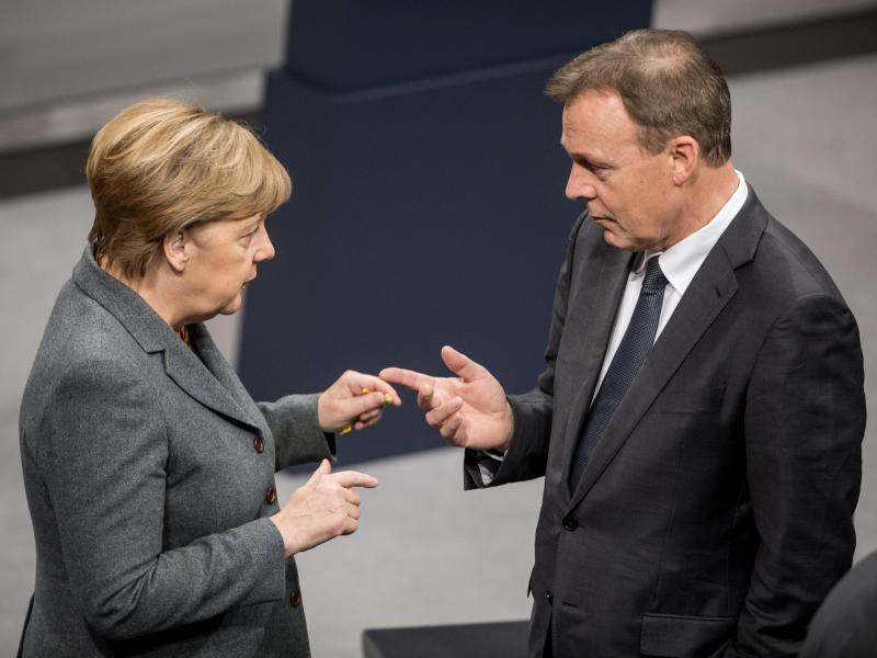 Bild zu Merkel und Oppermann