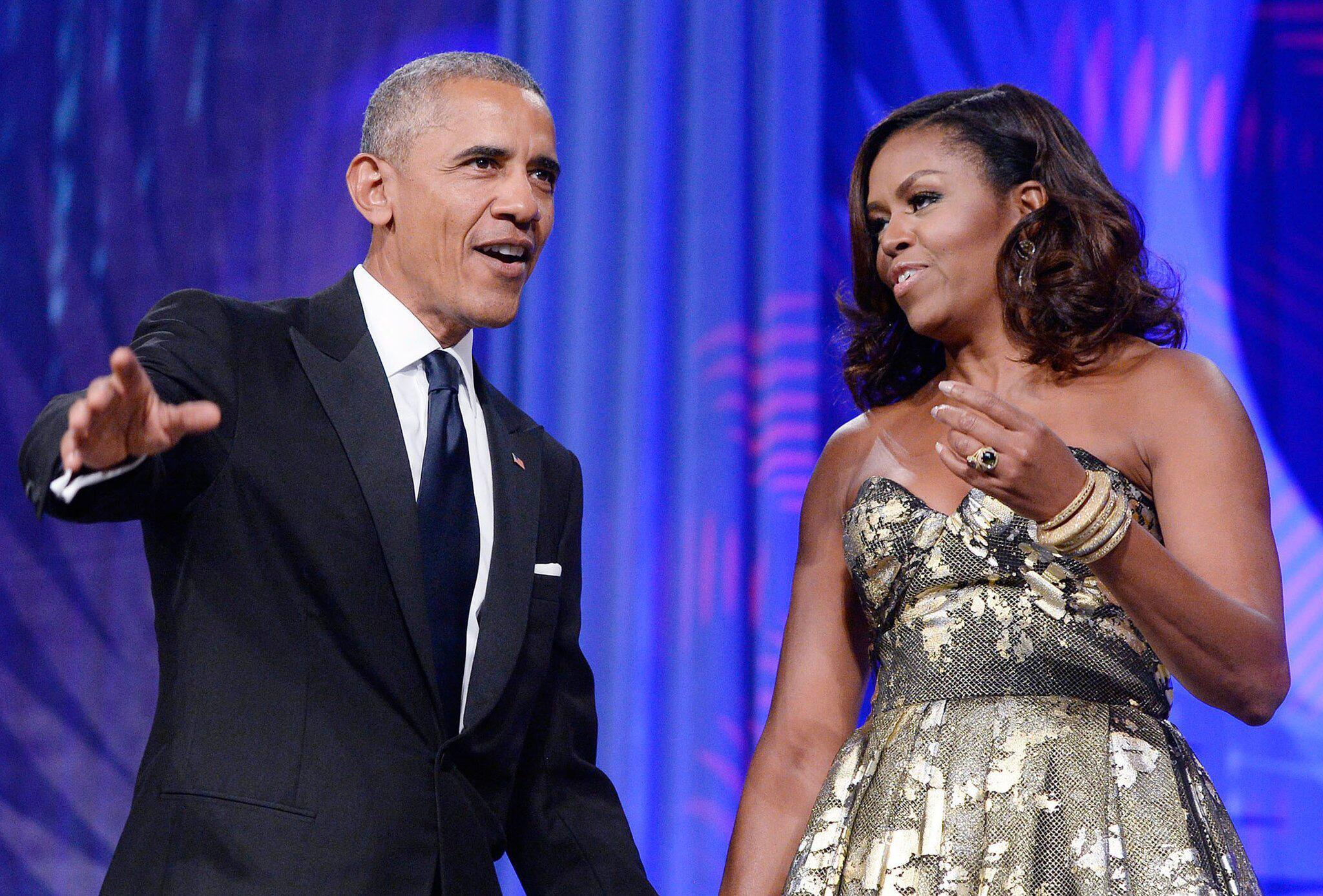 Bild zu Barack und Michelle Obama